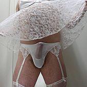 Crossdresser posing in nice-looking underware series.