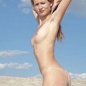 Blond beauty next door posing undressed on the wild sandy beach.
